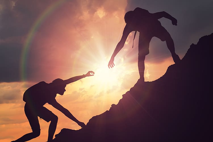 Contact image of men climbing mountain
